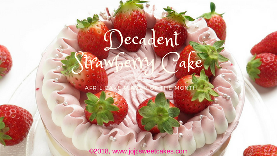 Decadent Strawberry Cake | April's cake flavor of the month is a sinfully delicious and decadent strawberry scratch cake. This cake is made with the freshest of ingredients including fresh strawberries and a homemade light creamy and oh-so-dreamy buttercream.| https://www.jojosweetcakes.com/decadent-strawberry-cake